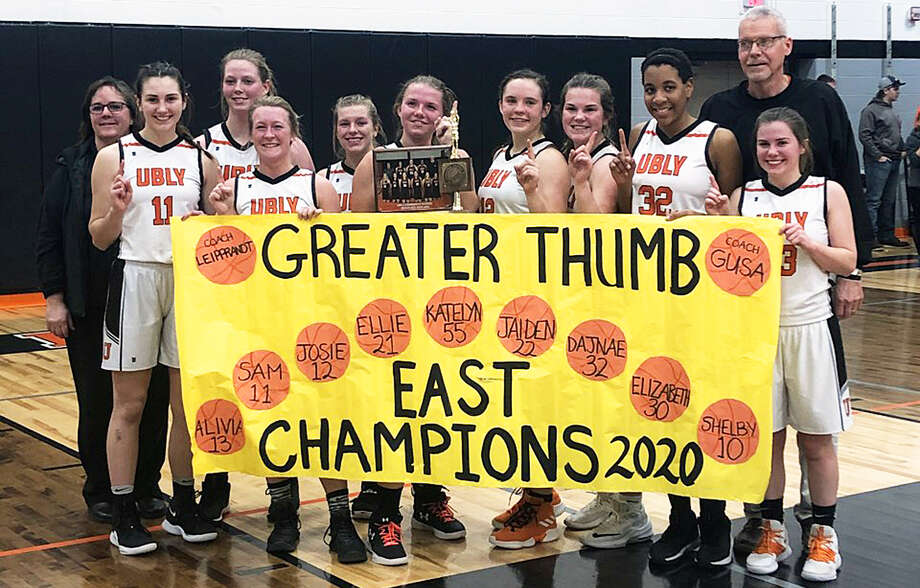 The 2019-2020 girls varisty basketball team celebrated winning the Greater Thumb Confernce Eat title after defeating the Brown City Green Devils on Thursday night. Photo: Submitted/Traci Souva