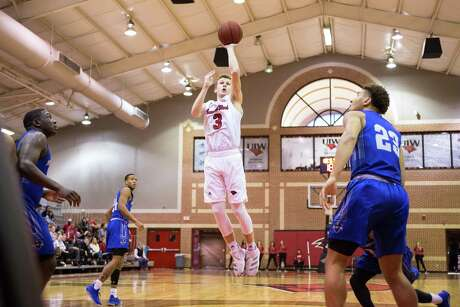Incarnate Word Cardinals freshman guard will Lutz attempts a floater during a game at the McDermott Center in San Antonio.