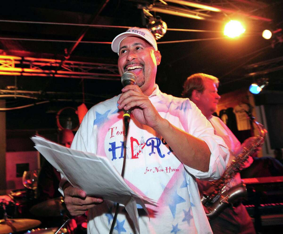 In this file photo, Jason Bartlett, then campaign manager for Toni Harp, announces results at the Keys to the City in New Haven in 2013.