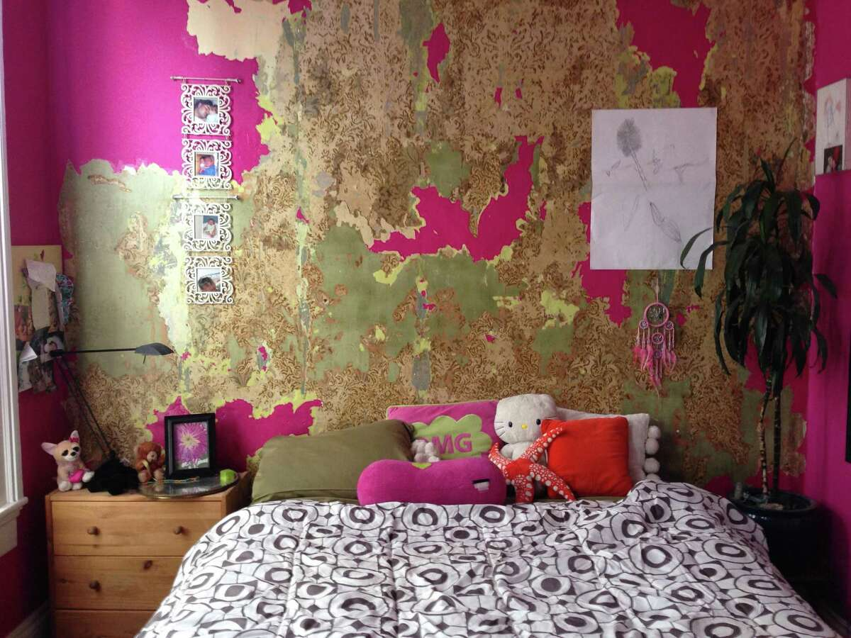 Terri Weist of Organic Interiors discovered this antique wallpaper and used it to stage a child's bedroom.