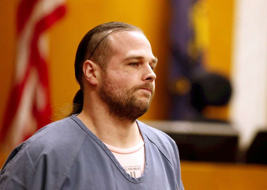 FILE - In this Mov. 15, 2017, file photo, MAX stabbing suspect Jeremy Christian appears in court in Portland, Ore. Two men who were fatally stabbed and a third who was severely injured in an attack on a Portland, Oregon light-rail train likely did not know the man charged in the case was holding a small folding knife when they confronted him, a prosecutor said in opening statements Tuesday, Jan. 28, 2020. Prosecutor Don Rees told jurors that no one on the train realized Christian had pulled the 4-inch knife from his pocket during a shoving match with the victims. Other passengers on the packed commuter train at rush hour thought the men had gotten into a fist fight until they saw blood spurting from the victims' necks, Rees said. (Beth Nakamura/The Oregonian via AP,File) Photo: Beth Nakamura / Associated Press