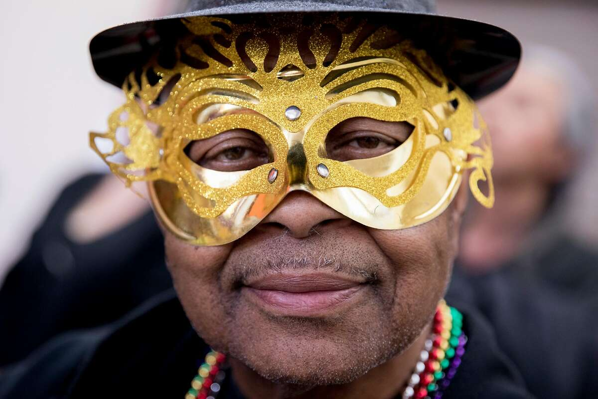 Ingleside neighbor James Taylor poses for a portrait while wearing a golden mask during a community Mardi Gras celebration held at the IT Bookman Community Center in the Ocean View neighborhood of San Francisco, Calif. Saturday, February 15, 2020. This local get-together was organized by community member Ms. Edna James with support from the Oceanview Library branch manager Lynne Maes.