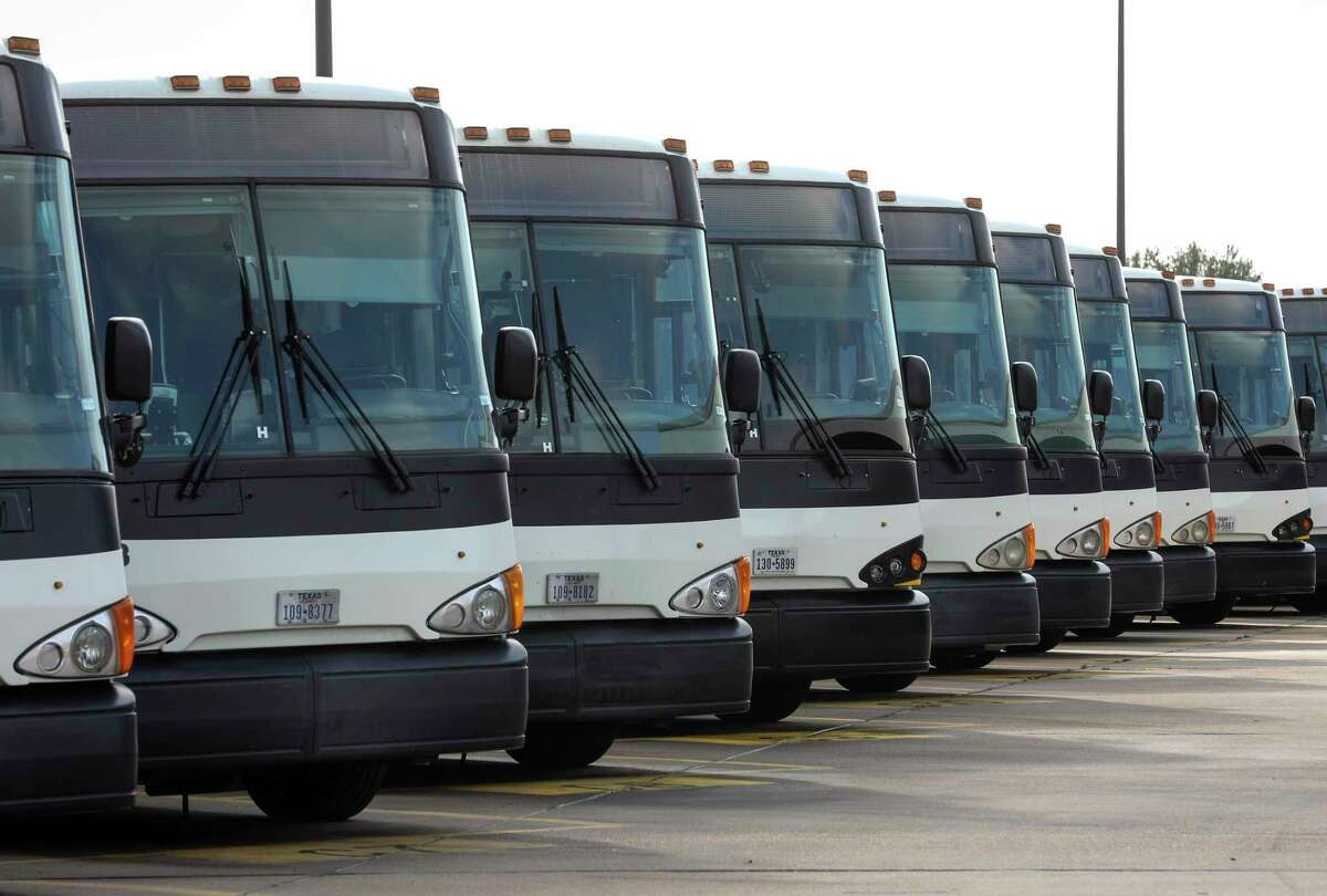 Metropolitan Transit Authority park and ride buses sit parked at the Hiram Clarke bus operating facility on Nov. 25, 2019, in Houston.