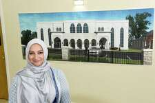 Malika Haider stands by an architectural drawing of the Al Fatemah Center which hangs in the center on Thursday, Feb. 6, 2020 in Albany, N.Y. (Lori Van Buren/Times Union)