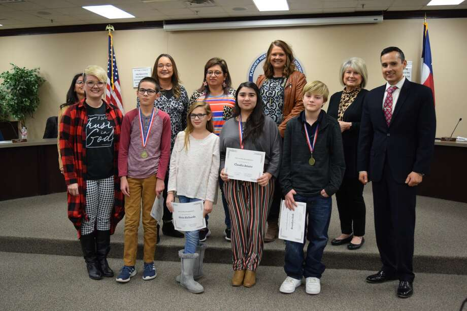 Coronado Middle School One Act Play students are recognized during Thursday evening's Plainview ISD School Board meeting. Pictured: (back, L-R) Board members JoAnn Rey, Sofia Rivera, Sylvia De La Garza, Amber Bass, Cheryl Dickerson and Superintendent H.T. Sanchez; (front, L-R) Milea Huckeby, Benjamin Beaty, Alexis Richards, Claudia Amato and Braidyn Sisk Photo: Ellysa Harris/Plainview Herald