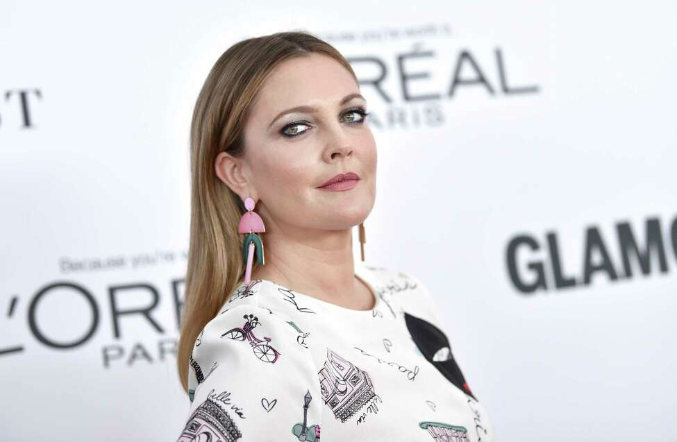 FILE - In this Nov. 13, 2017 file photo, Drew Barrymore attends the 2017 Glamour Women of the Year Awards at Kings Theatre in New York. EgyptAir is trying to shift the blame to a local advertising agency for a bizarre article in its in-flight magazine purportedly based on an interview with actress Drew Barrymore. In a statement late Monday, Oct. 8, 2018 the airline said it has an agreement with Al-Ahram advertising agency, which edits articles and interviews for its in-flight magazine, Horus. (Photo by Evan Agostini/Invision/AP, File)