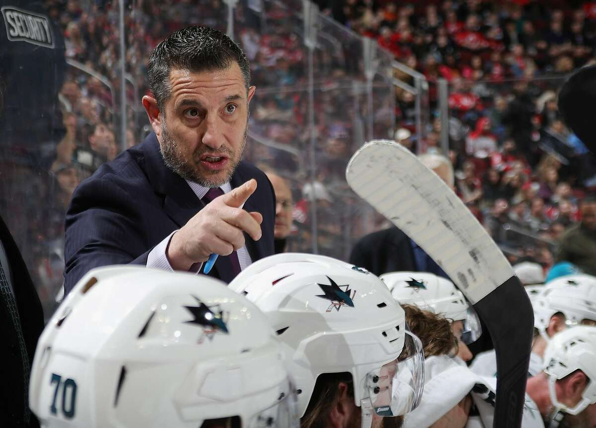 NEWARK, NEW JERSEY - FEBRUARY 20: Interim head coach Bob Boughner of the San Jose Sharks handles bench duties during the game against the New Jersey Devils at the Prudential Center on February 20, 2020 in Newark, New Jersey. (Photo by Bruce Bennett/Getty Images)