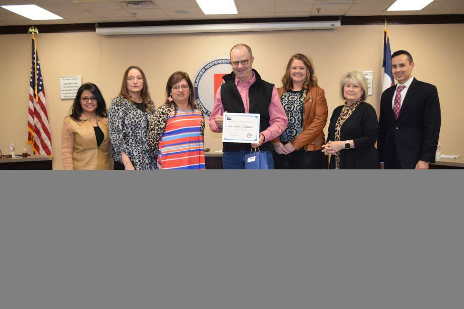 Dr. Toby Brown is recognized by the Plainview ISD School Board for his services to students. Photo: Ellysa Harris/Plainview Herald