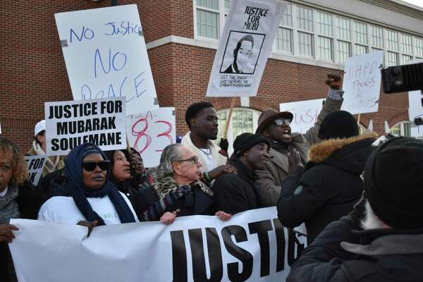 Family, friends and supporters of Mubarak Soulemane, shot and killed by state police Jan. 15, rallied for justice Friday in West Haven.
