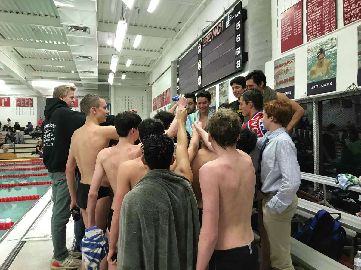 The Norwalk/McMahon boys swimming team gathers after it lost to host Greenwich on Friday, Feb. 21, 2020.