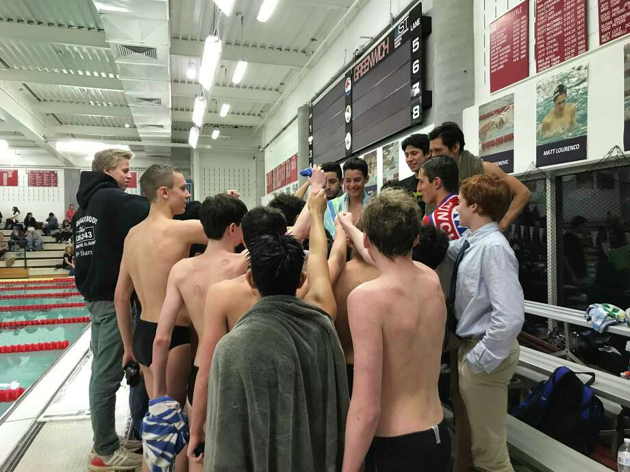 The Norwalk/McMahon boys swimming team gathers after it lost to host Greenwich on Friday, Feb. 21, 2020. Photo: David Fierro / Hearst Connecticut Media