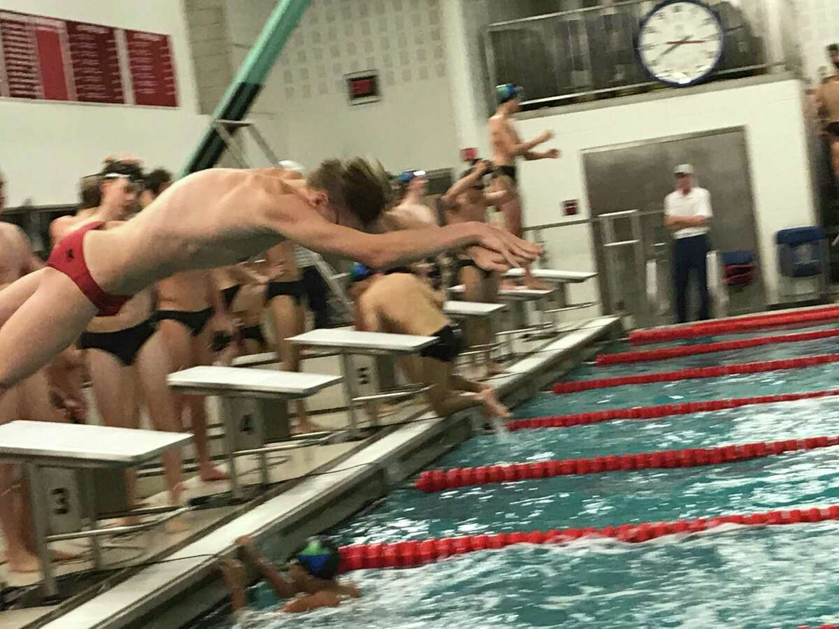 The Greenwich boys swimming team capped a 12-0 season with a victory against visiting Norwalk/McMahon Friday, Feb. 21, 2020.