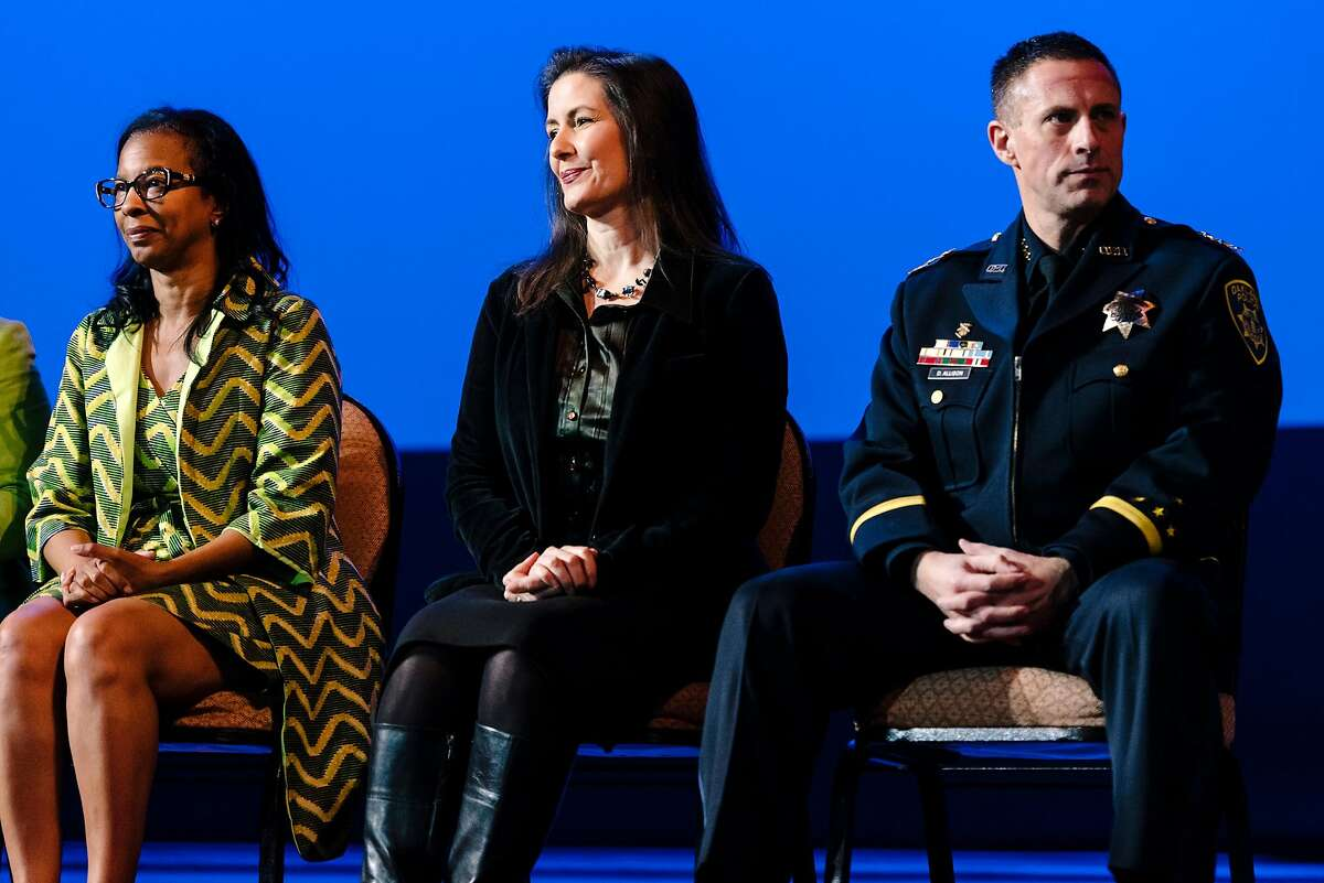 Acting Oakland Police Chief Darren Allison, right, Oakland Mayor Libby Schaaf, and Oakland Police Commission chair Regina Jackson sit on stage during the Oakland Police Department's 183rd Basic Recruit Academy Graduation held at the Scottish Rite Center in Oakland, California, on Friday, Feb. 21, 2020. The Oakland Police Commission voted unanimously in a closed session on Thursday to fire Police Chief Anne Kirkpatrick.