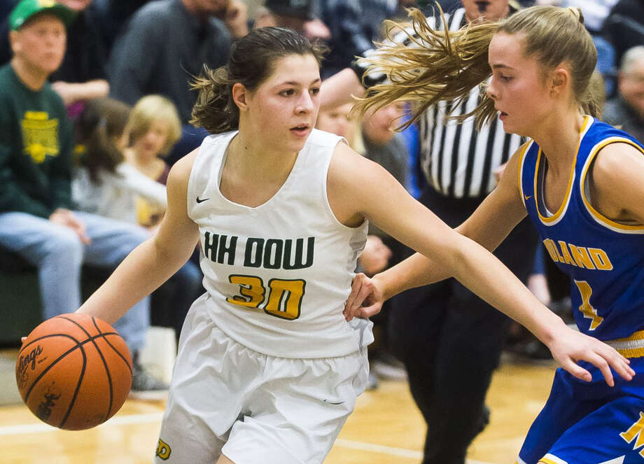 Dow High's Katelyn Murray handles the ball during a Jan. 31, 2020 game against Midland High. Murray was the defensive catalyst for the Chargers' 56-31 SVL North championship-clinching win over Bay City Western on Friday. Photo: Daily News File Photo