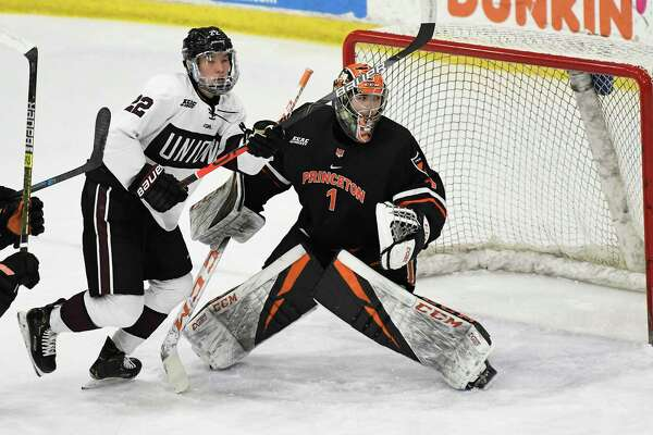 Princeton goaltender Jeremie Forget (1) defends against Union forward Parker Foo (22) during the first period an NCAA hockey game in Schenectady, N.Y.,