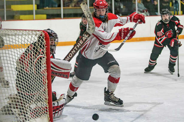 Alton senior forward Drayven Norton is denied by Triad goalie Logan Teater as the Knights ended the Redbirds' season Thursday night at East Alton Ice Arena with a 5-3 win in Game 3 of the Mississippi Valley Club Hockey Association Class 1A semifinal.