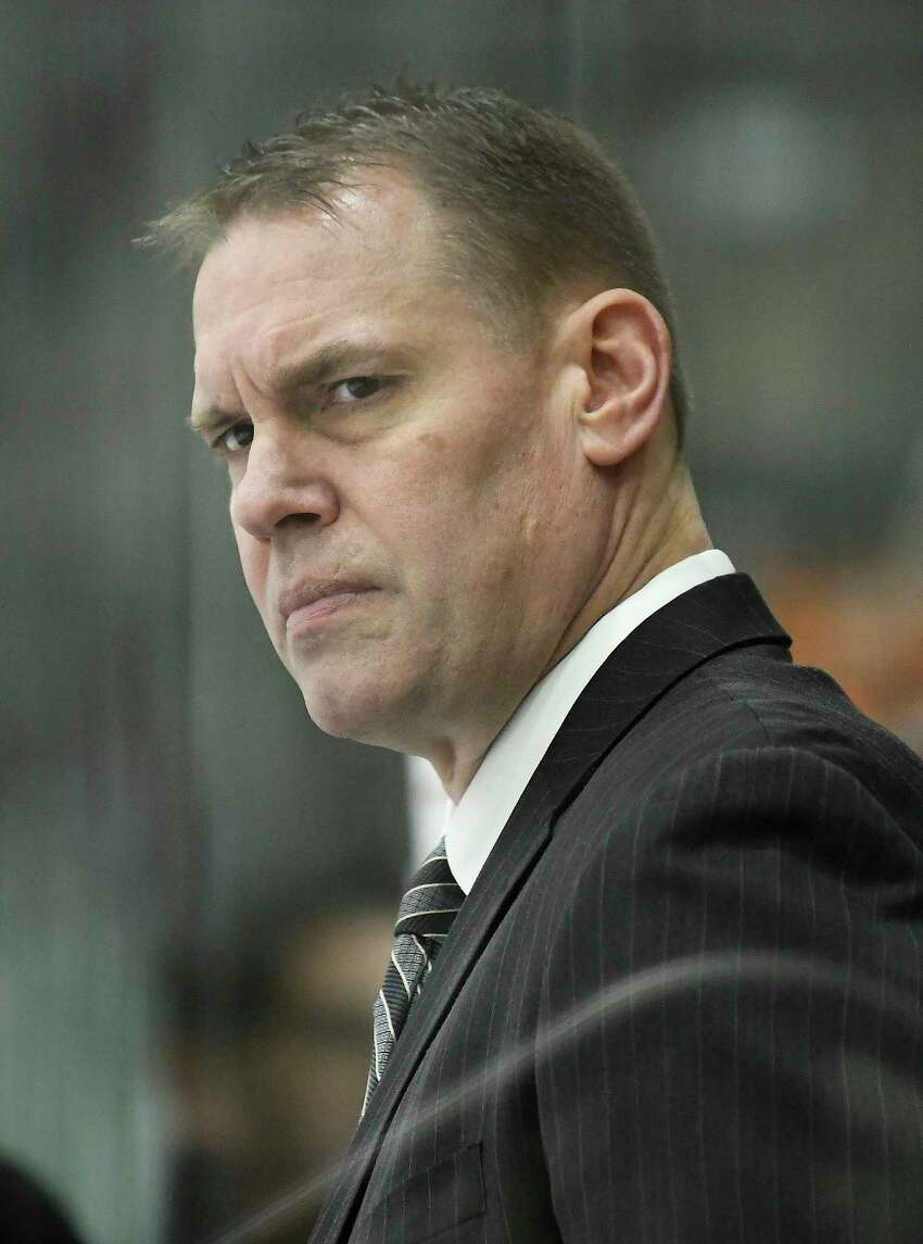 Union head coach Rick Bennett instructs his players against Princeton during the second period an NCAA hockey game in Schenectady, N.Y.,