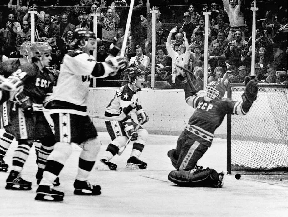 The U.S. Olympic hockey players, mostly a collection of collegians, celebrate the winning goal against the Soviet Union, made up mostly of professionals, on Feb. 22, 1980, at Lake Placid, N.Y. Photo: Barton Silverman / New York Times 1980