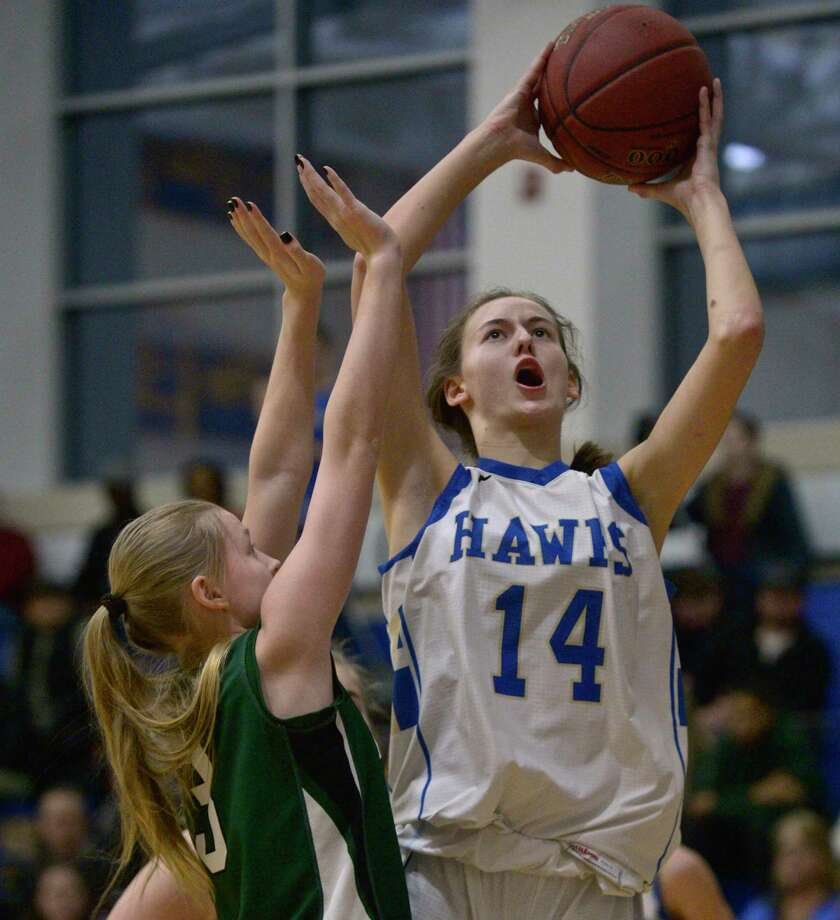 Newtown's Juliette Cryder (14) goes up with the ball over New Milford's Anna Holcomb (3) in the girls' SWC basketball tournament quarterfinal game on Friday night at Newtown High School. Photo: H John Voorhees III / Hearst Connecticut Media / The News-Times