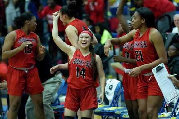 Langham Creek players react after beating Oak Ridge high school in a Region II-6A area girls basketball playoff during the second half at Klein high school, Tuesday, Feb. 21, 2020.