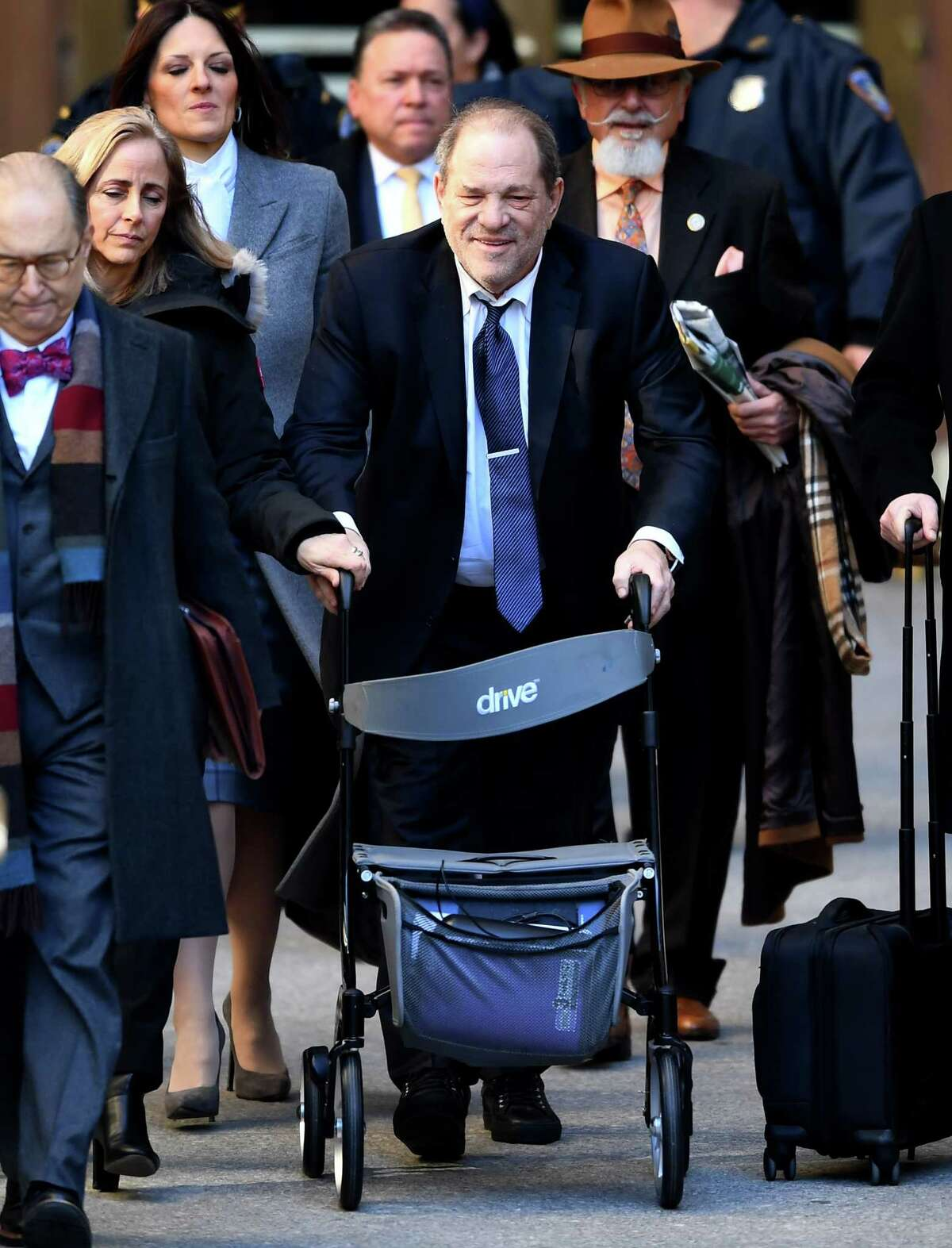 Harvey Weinstein leaves the Manhattan Criminal Court, as a jury continues with deliberations on February 21, 2020 in New York City. - The disgraced movie mogul, 67, faces life in prison if the jury of seven men and five women convict him of a variety of sexual misconduct charges in New York. (Photo by Johannes EISELE / AFP) (Photo by JOHANNES EISELE/AFP via Getty Images)