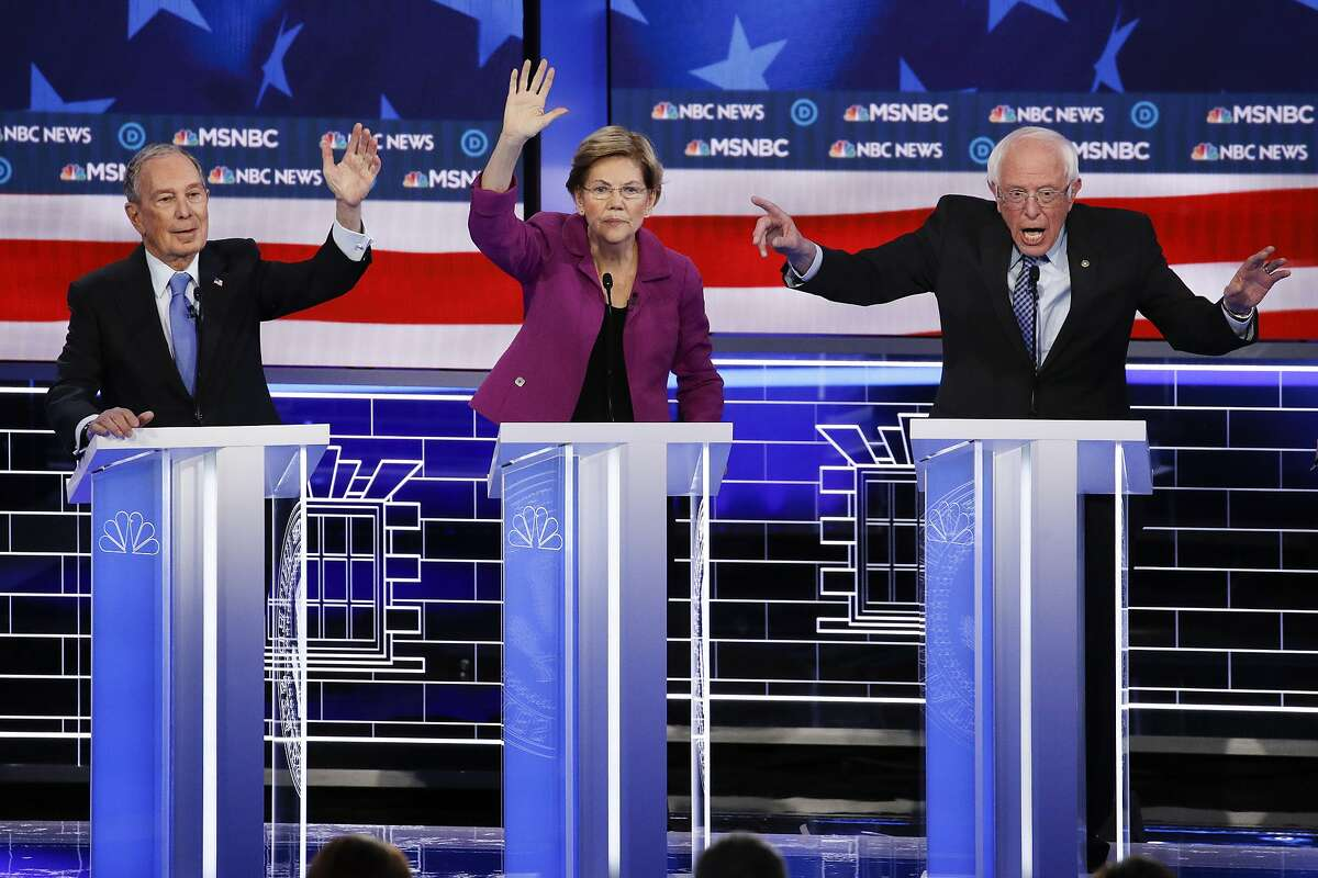 From left, Democratic presidential candidates, former New York City Mayor Mike Bloomberg, Sen. Elizabeth Warren, D-Mass.; and Sen. Bernie Sanders, I-Vt., participate in a Democratic presidential primary debate Wednesday, Feb. 19, 2020, in Las Vegas. Seven casino-resorts are among 200 caucus locations statewide that will host the presidential caucuses on Saturday.