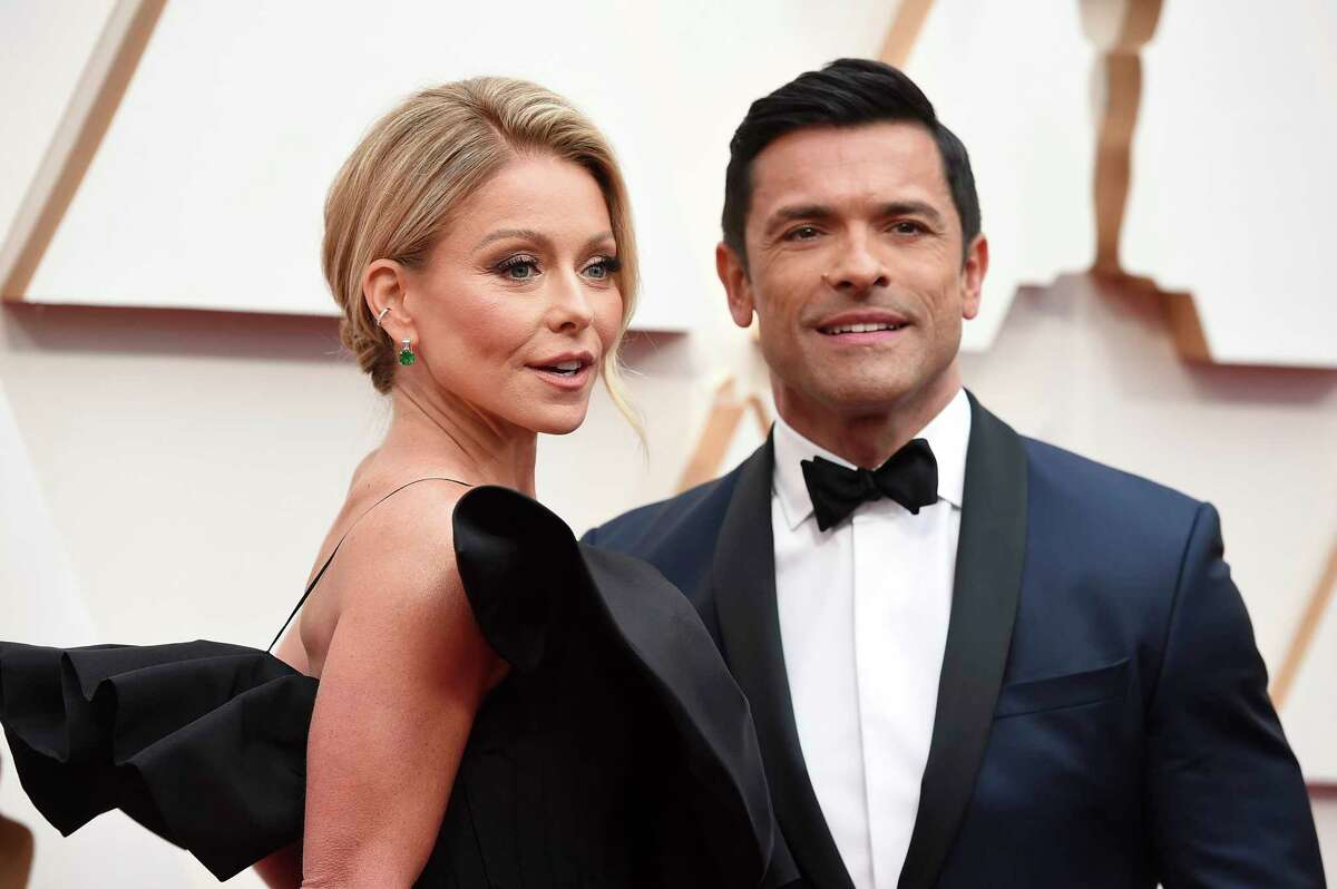 Kelly Ripa, left, and Mark Consuelos arrive at the Oscars on Sunday, Feb. 9, 2020, at the Dolby Theatre in Los Angeles. (Photo by Jordan Strauss/Invision/AP)