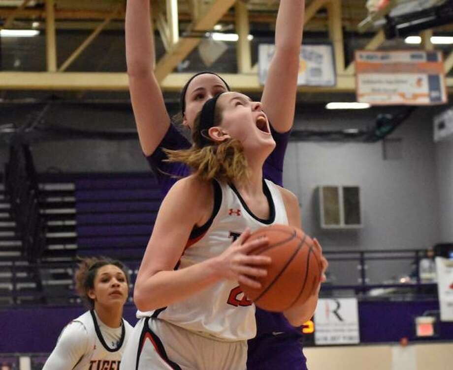 Edwardsville center Katelynne Roberts goes up for a contested shot in the first quarter against Collinsville. Photo: Matt Kamp   For The Telegraph