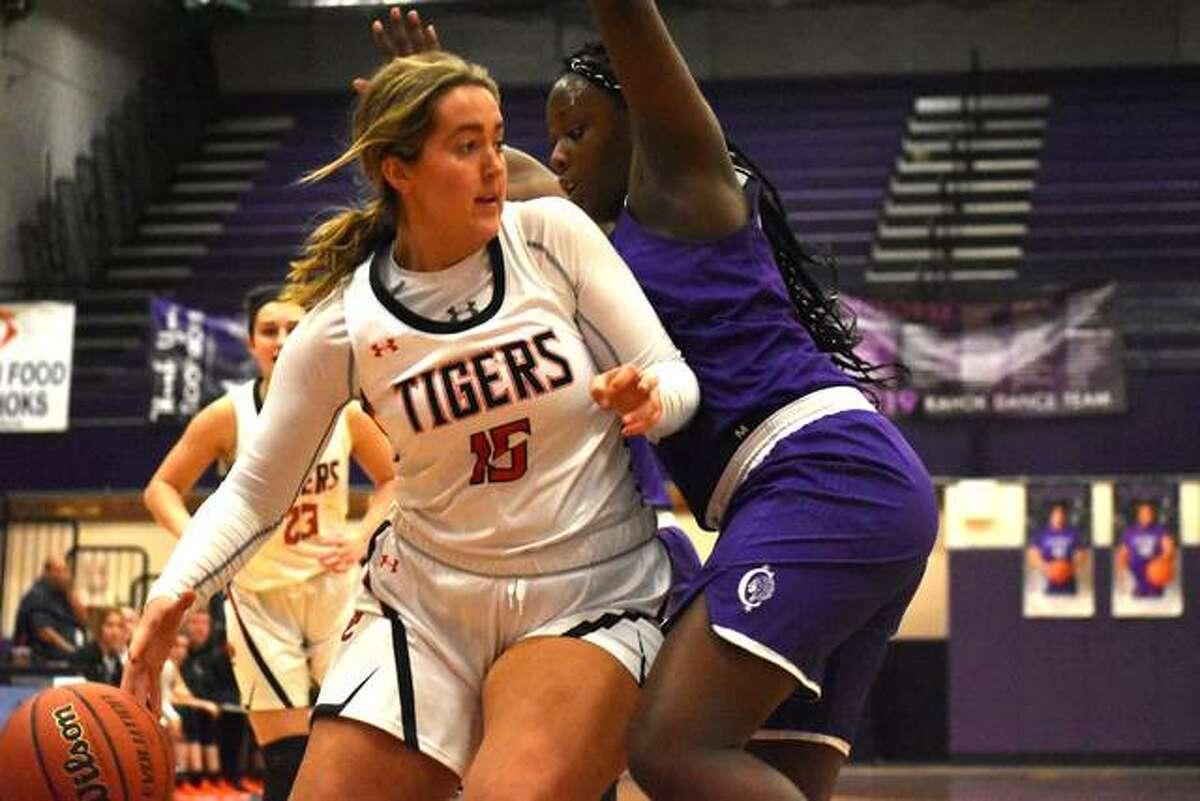 Edwardsville forward Kylie Burg looks for room on the baseline.