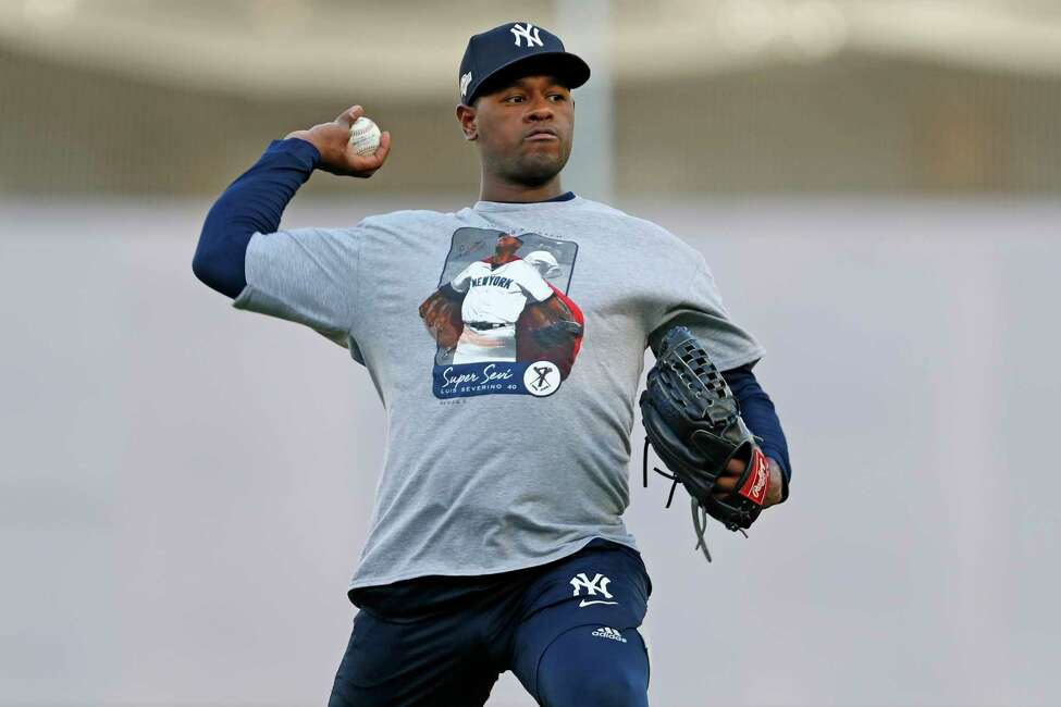 New York Yankees starting pitcher Luis Severino throws on an empty field, Monday, Oct. 14, 2019, at Yankee Stadium in New York, on an off day during the American League Championship Series between the Yankees and the Houston Astros. (AP Photo/Kathy Willens)