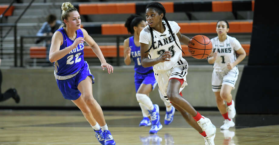 Hightower senior forward Destini Lombard (23) pushes the ball upcourt against Barbers Hill sophomore forward Rachel Sarlis (22) during the 4th quarter of their UIL Girls' Basketball Region II Conference 5A Area Playoff matchup at LaPorte High School on Feb. 21, 2020. Photo: Jerry Baker/Contributor