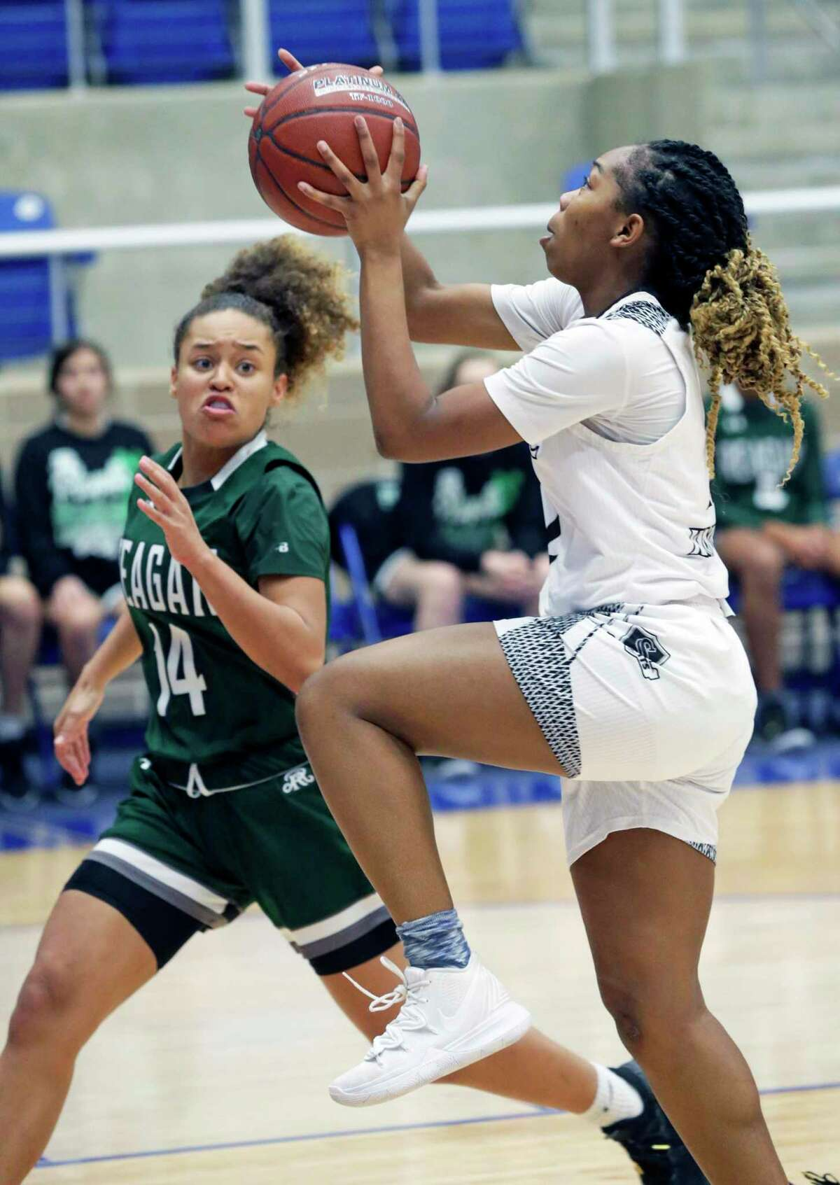 Lady Knight guard Aaliyah Ellis gets to the hoop before Nadja Wilson as Steele plays Reagan and Wagner plays Sam Houston in a girls basketball playoff double header at Northside Gym on Feb. 21, 2020.