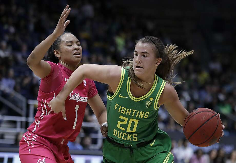 Oregon's Sabrina Ionescu, right, drives as California's Leilani McIntosh (1) defends during the second half of an NCAA college basketball game Friday, Feb. 21, 2020, in Berkeley, Calif. (AP Photo/Ben Margot) Photo: Ben Margot, Associated Press