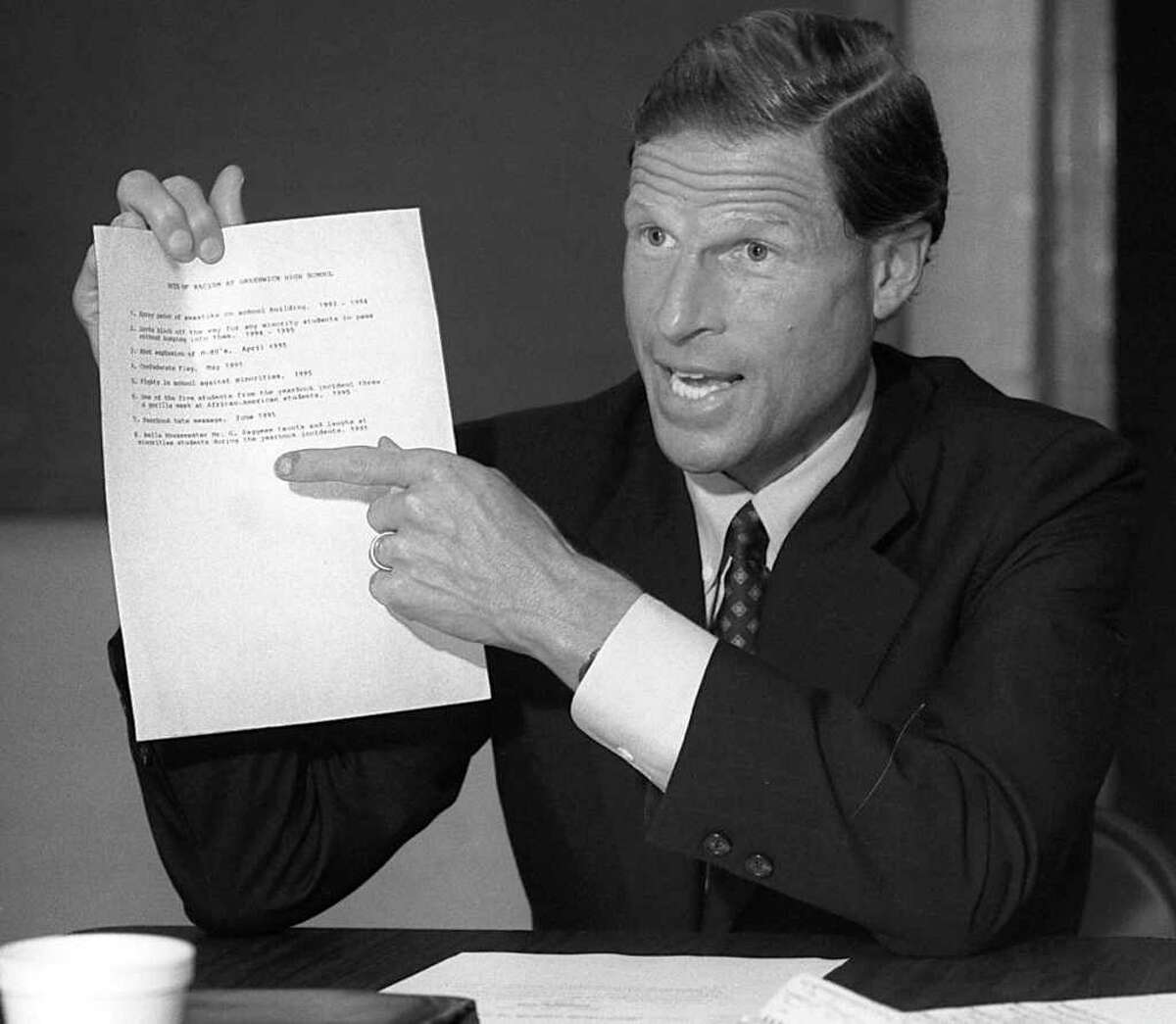 Connecticut Attorney General Richard Blumenthal points to a list of recent racial incidents at Greenwich High School during a meeting organized by Joyce McKenzie of the Armstrong Court housing complex in Greenwich in July 1995. Blumenthal was handed the list by someone at the meeting and was pointing at it in agreement that there seemed to be a problem at the school.