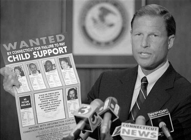 Connecticut Attorney General Richard Blumenthal unveils a 'wanted' poster of six of the most serious child support delinquents at a press conference at his office in Hartford, Conn. Monday, June 19, 1995. Together the six men on the poster owe a total of nearly $400,000 in back child support payments. The posters will be displayed in convenience stores, grocery stores and post offices throughout the state. (AP Photo/John Dunn) Photo: ST