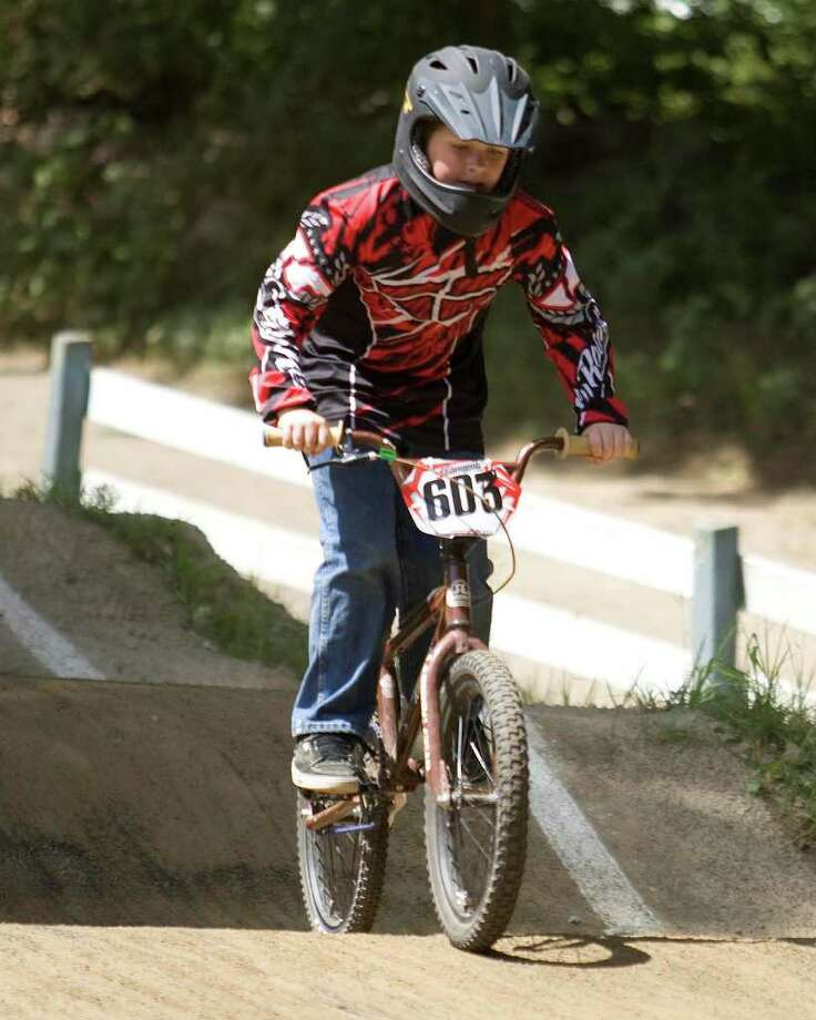 Jimmy Godfrey, 11, of Bethel, competes in the Northeast Regional BMX Championships Saturday at the BMX course at Mitchell Park in Bethel. The races drew riders from all 13 original colonies and Canada. Photo: Barry Horn / The News-Times Freelance