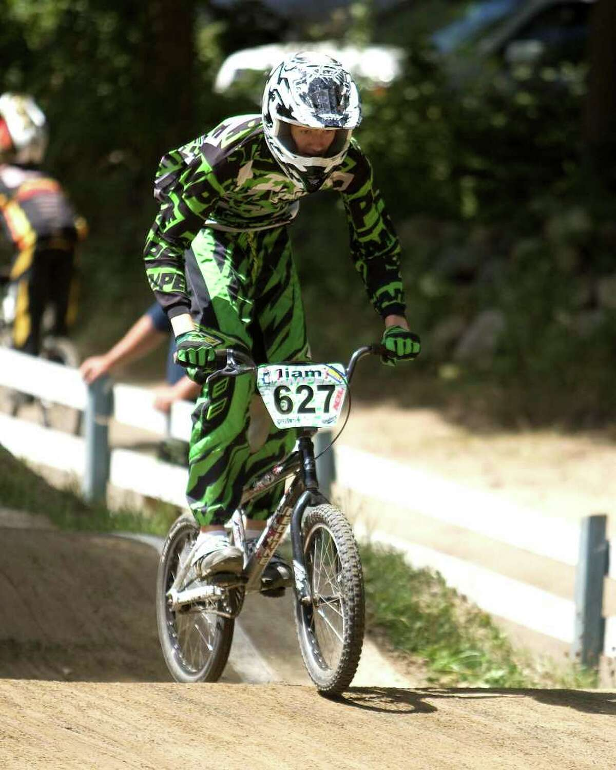 Liam Stone, 16, of New Milford, works hard during competition in the Northeast Regional BMX Championships Saturday at Mitchell Park in Bethel.