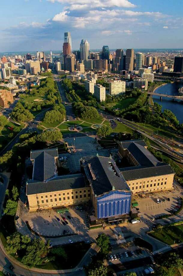 In the foreground, the Philadelphia Museum of Art rises majestically at the end of the Benjamin Franklin Parkway. Constructed of Minnesota Dolomite and completed in 1928, the museum covers 10 acres and houses more than 200,000 works spanning 2,000 years. Photo: Contributed Photo /  Bob Krist