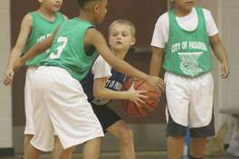 Surrounded by three opponents, this young man in the blue jersey sure could use some teammates to help him get out of this jam. Avoiding jams like this will be big for the youth basketball teams in Saturday's playoffs.