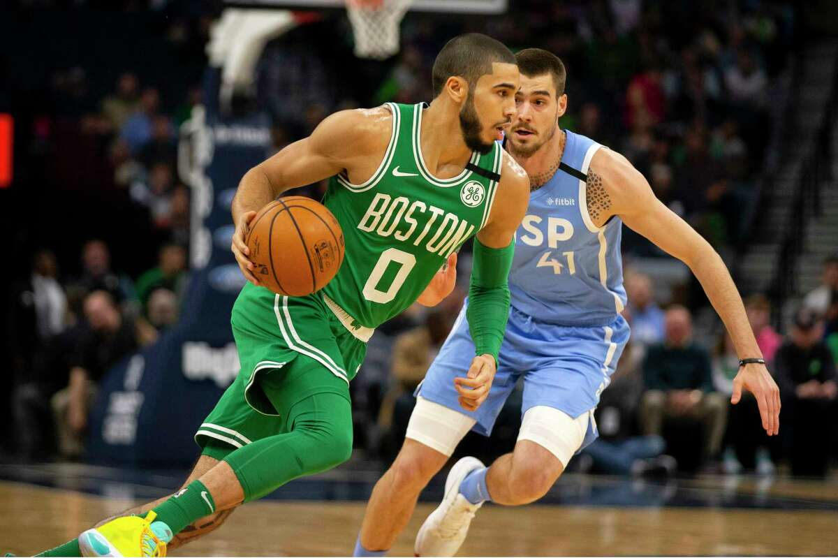 Boston Celtics guard Jayson Tatum (0) drives against Minnesota Timberwolves forward Juancho Hernangomez (41) in the first quarter of an NBA basketball game Friday, Feb. 21, 2020, in Minneapolis. (AP Photo/Andy Clayton-King)