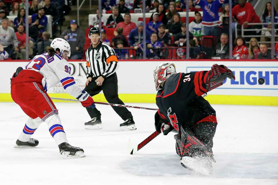 New York Rangers center Mika Zibanejad (93), of Sweden, shoots and scores against Carolina Hurricanes goaltender Petr Mrazek (34), of the Czech Republic, during the first period of an NHL hockey game in Raleigh, N.C., Friday, Feb. 21, 2020. (AP Photo/Gerry Broome)