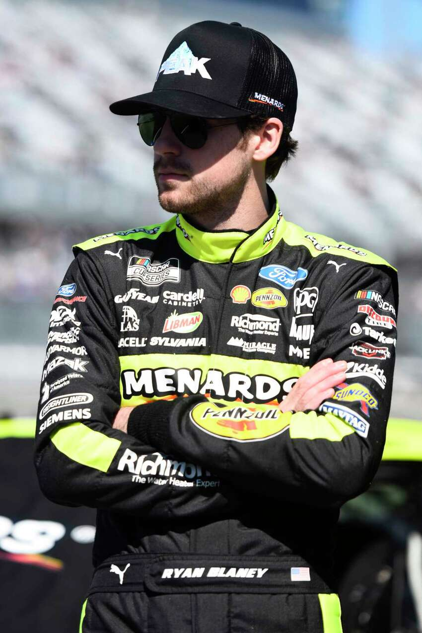 DAYTONA BEACH, FLORIDA - FEBRUARY 09: Ryan Blaney, driver of the #12 Menards/Peak Ford, stands on the grid during qualifying for the NASCAR Cup Series 62nd Annual Daytona 500 at Daytona International Speedway on February 09, 2020 in Daytona Beach, Florida. (Photo by Jared C. Tilton/Getty Images)