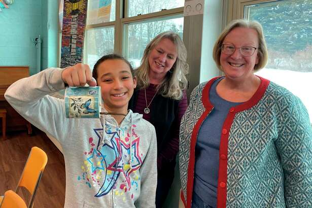 Anuksa Saffron holds a coffee mug bird feeder she made. Also pictured are Spirit of the Woods Garden Club members Kathy Johnson and Connie Veverica. (Courtesy photo)