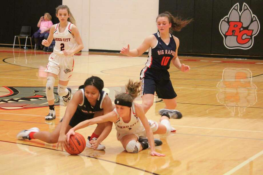 Big Rapids' Eden Short (left) and ReedCIty's Taylor Harrison (right) battle for the ball during Friday night's CSAA Gold contest. (Pioneer photo/John Raffel)