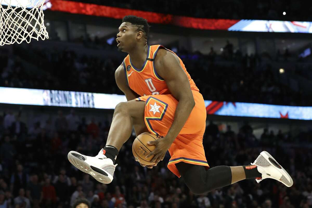 U.S. forward Zion Williamson, of the New Orleans Pelicans, goes up for a dunk during the second half of the NBA Rising Stars basketball game in Chicago, Friday, Feb. 14, 2020. (AP Photo/Nam Y. Huh)
