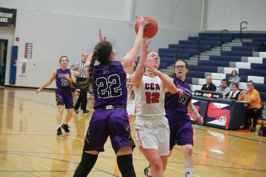 CCA's Allie Angell (12) looks to make a play in recent girls basketball action. (Pioneer photo/John Raffel)