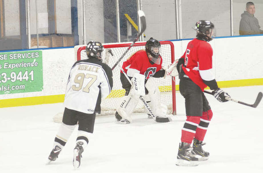 Alexa Dixon, goalie for the Chatham Glenwood Titans, plays in her last high school game earlier this week. Dixon plans on playing ice hockey in college. Photo: Darren Iozia | Journal-Courier