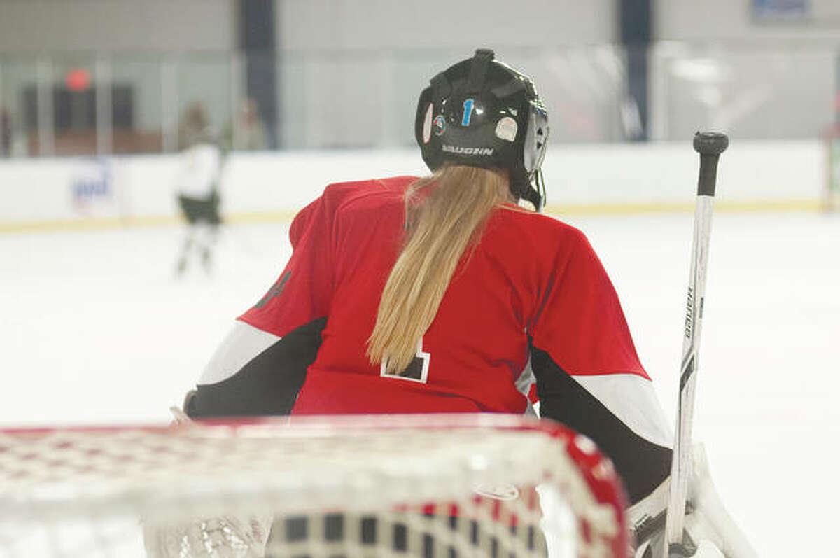 Jacksonville High School senior Alexa Dixon is one of two girls on the Chatham Glenwood Titans' hockey team roster.