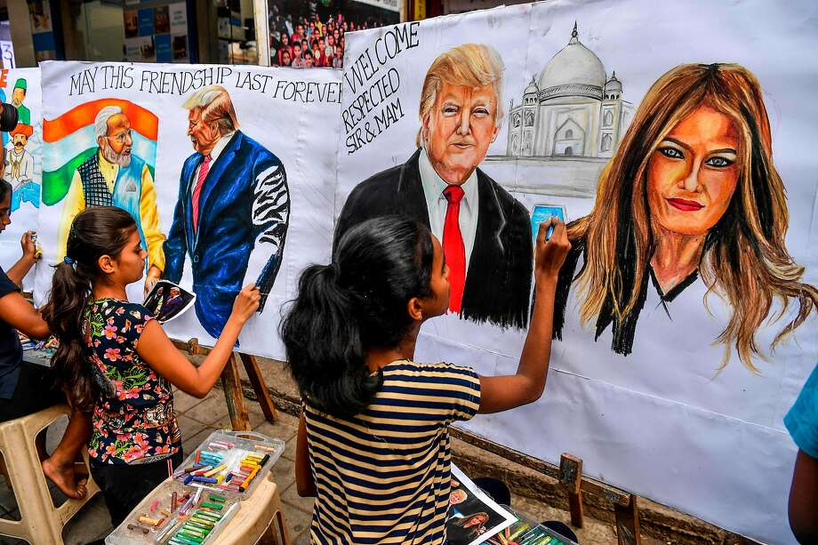 Students paint portraits of President Trump, his wife, Melania, and Indian Prime Minister Narendra Modi in Mumbai on Friday. Trump visits the western city of Ahmedabad on Monday. Photo: Indranil Mukherjee / AFP Via Getty Images