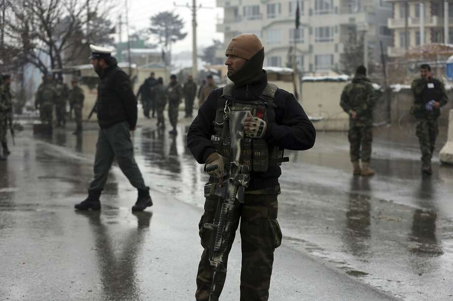 An army soldier guards the site of suicide attack near the military academy in the capital of Kabul on Feb. 11. Photo: Rahmat Gul / Associated Press